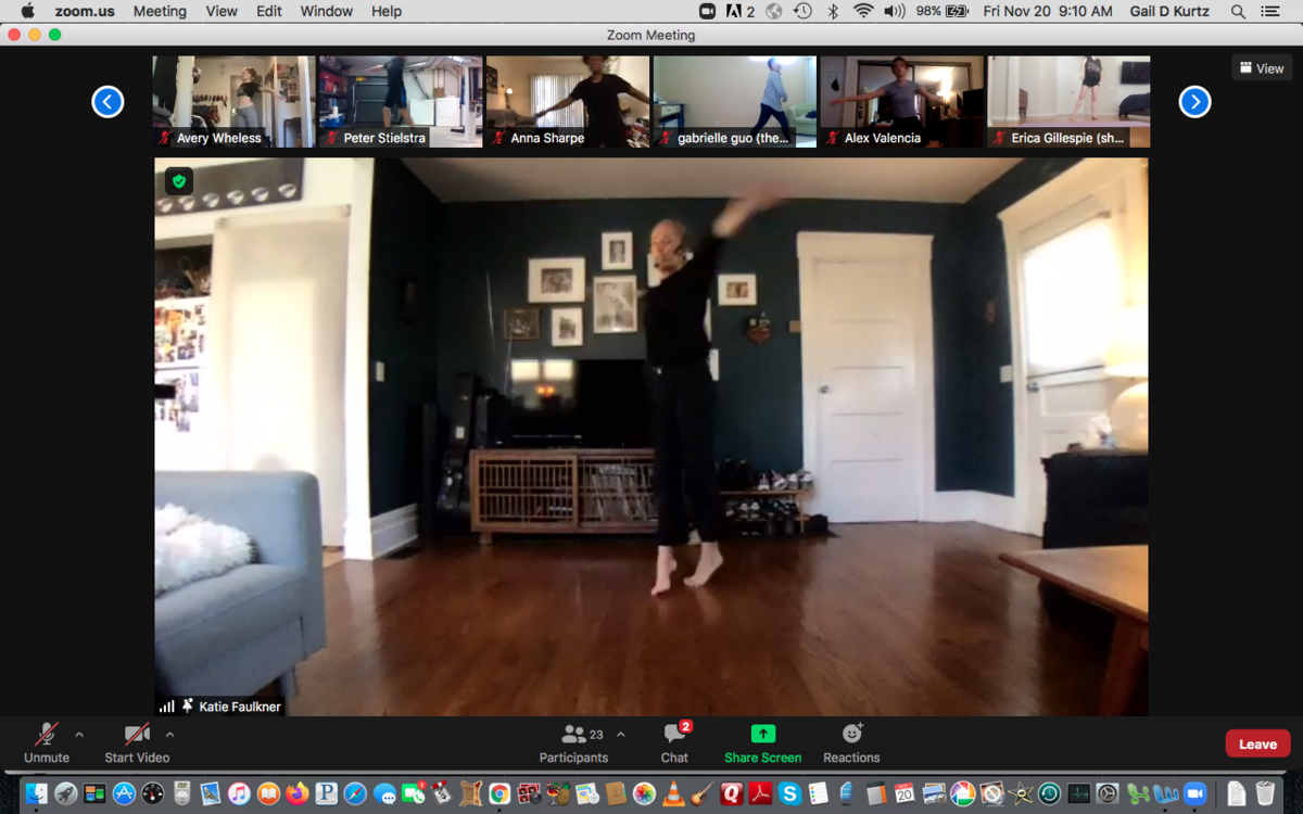 Screen grab of dance instructor in motion on Zoom, with class attendees along the top of the screen