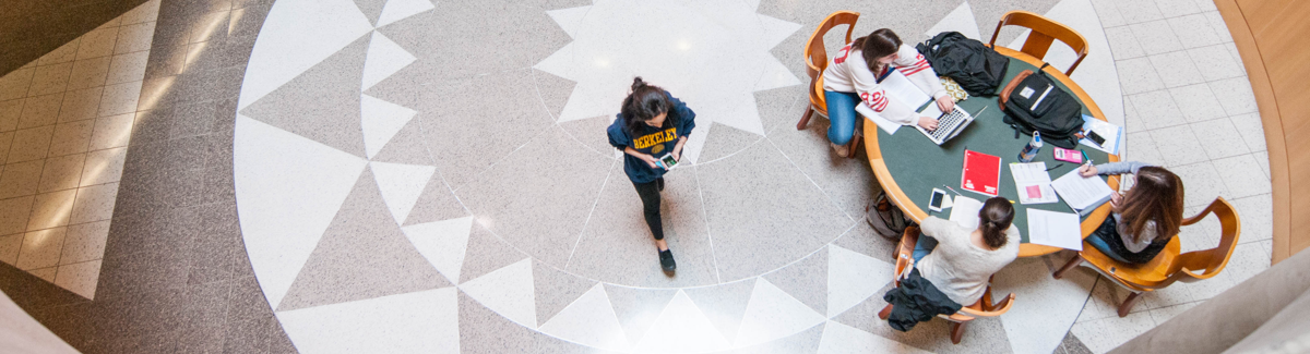 Overhead shot of student walking through library