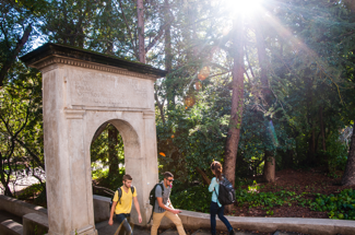 Students walking through arch on campus