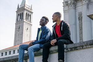 Tellum (left), ASUC president, sitting with a friend