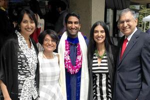 Dubal family posing at graduation