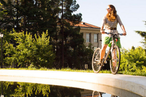 Woman biking on campus
